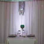 Stunning crystal curtains against white sheers for the sweetheart table