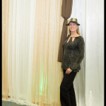 Photo booth backdrop with gold and ivory sheer draeps
