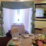 Sage Green, white sheers, and crystal curtains in this elegant canopy for the bride and groom.
