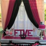 Fuchsia, blush, black, & white Pipe and Drape with Crystal Chandelier