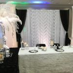 Gatsby inspired Black, White and Silver backdrop with rhinestone tiebacks.