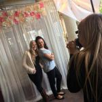 Flower valance and sheer drapes make for a romantic photo backdrop
