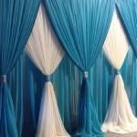 Our popular Turquoise and White sheer Criss Cross pattern drape design