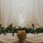 White and Ivory silk flowerwall with white drapes