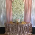 Silk flowerwall with white, ivory, and blush roses, blush and white drapes and rose gold sequin linen