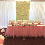 Our flower wall with white sheers as backdrop for head table at this bridal shower at The Yorba Linda Community Center.