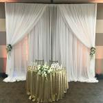 Classic white sheer pipe and drape with floral tie backs at Vellano Country Club Chino Hills.