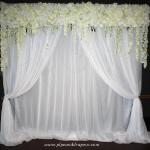Our silk flower valance with white sheer drapes and classic swags.