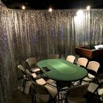 40' wall of silver sequin pipe and drape for Casino area at this New Years Eve party!